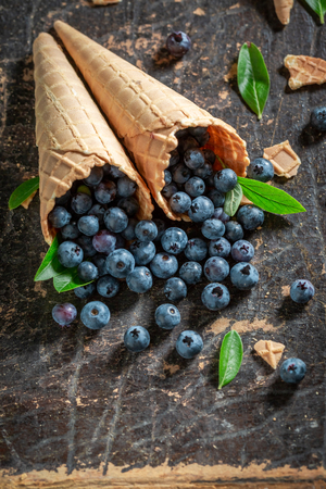 Sweet blueberries in waffels as ice cream concept