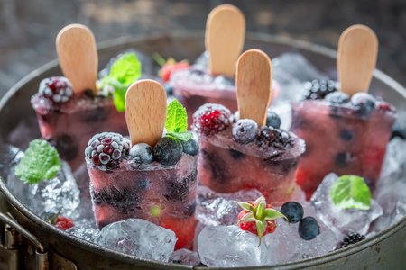 Homemade berry fruits ice cream on a stick