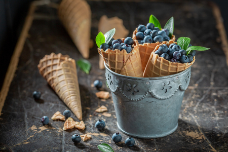 Sweet blueberries in waffels as concept of ice cream