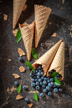 Fresh blueberries in waffels as concept of ice cream