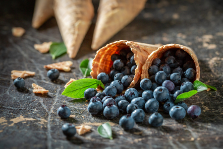 Juicy blueberries in waffels as ice cream concept