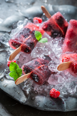 Sweet ice cream with berries on cold ice