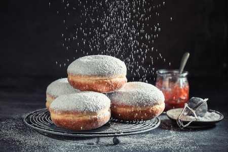 Delicious and sweet donuts with powdered sugar