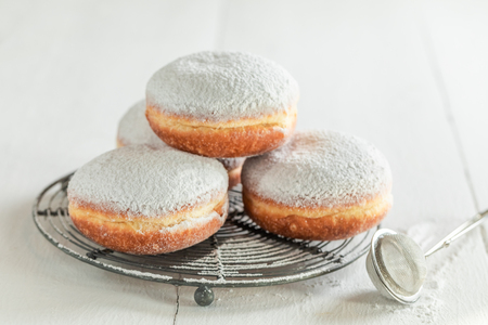 Sweet and brown donuts with powdered sugar