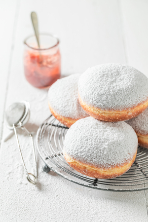 Tasty and homemade donuts with powdered sugar