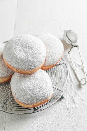 Sweet and fresh donuts with powdered sugar