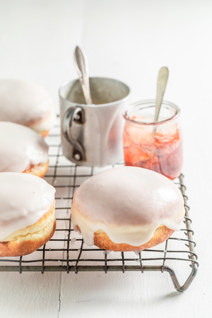 Delicious and sweet donuts with red jam Stock Photo