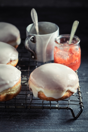 Tasty and homemade donuts with red jam