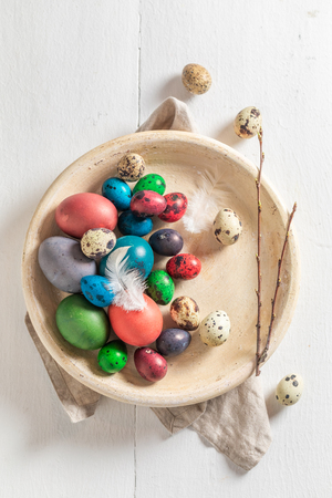 Colourfull Easter eggs in old clay plate