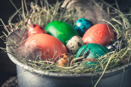 Closeup of color eggs for Easter on hay Stock Photo