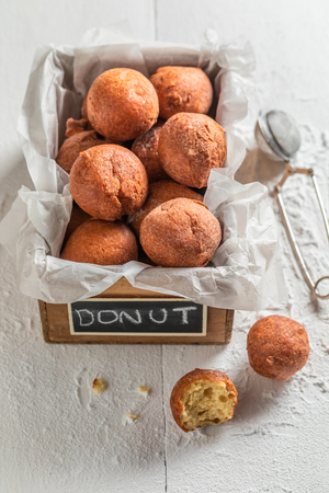 Tasty and homemade donuts balls with powdered sugar