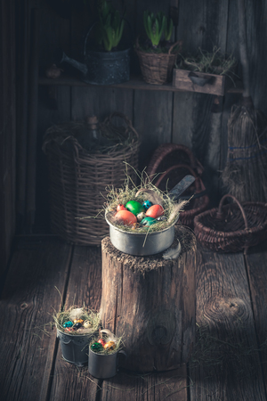 Various Easter eggs with feathers in rural hut