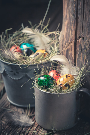 Closeup of Easter eggs in old metal cup Stock Photo