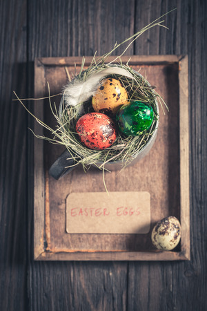 Eggs for Easter in the rustic mug on wooden table Stock Photo