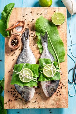 Top view of preparing whole fish with horseradish and lemon Stock Photo