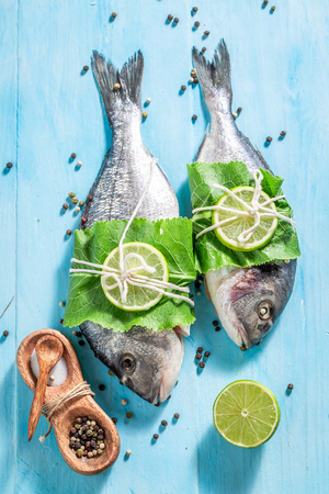 Top view of sea bream with salt and pepper