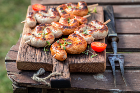 Spicy grilled and twisted sausage with spices and herbs
