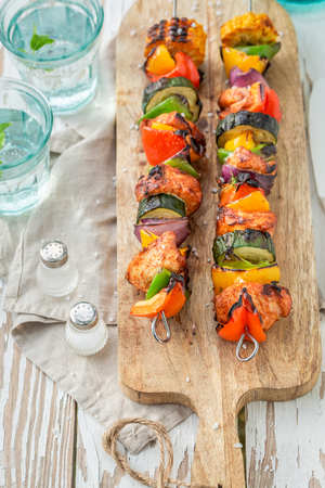 Healthy grilled skewers made of meat and vegetables