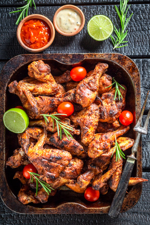 Grilled chicken leg with rosemary and spices