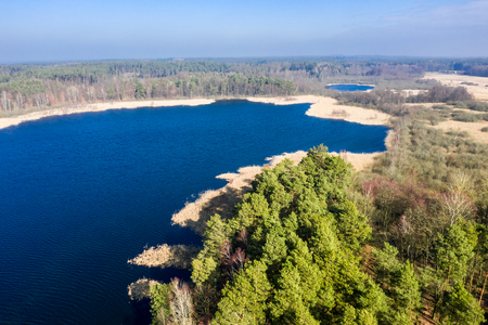 Aerial view of wonderful lake and forest, Poland 스톡 콘텐츠
