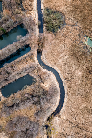 Flying above odd swamps and river in Poland Stock Photo