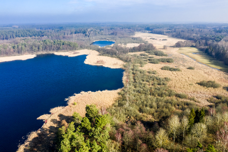Flying above wonderful lake and forest, Poland 스톡 콘텐츠