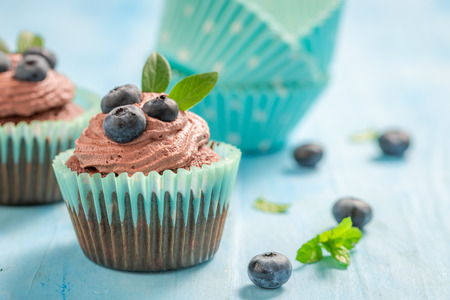 Closeup of cupcake with blueberries and chocolate cream 写真素材