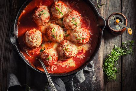 Spicy meatballs with tomato sauce and cheese
