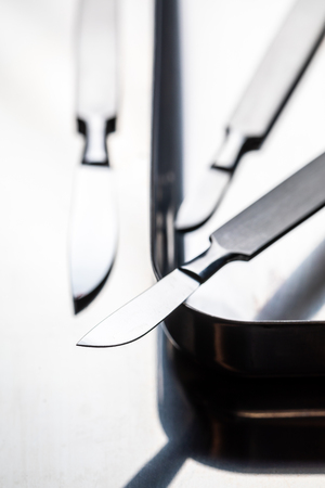 Closeup of scalpels on stainless steel table