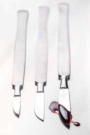 Closeup of scalpels with a small amount of blood