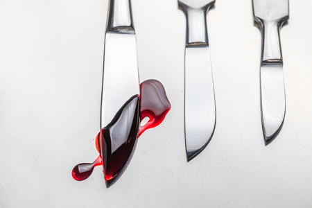 Sharp surgical scalpels with a small amount of blood Stock Photo