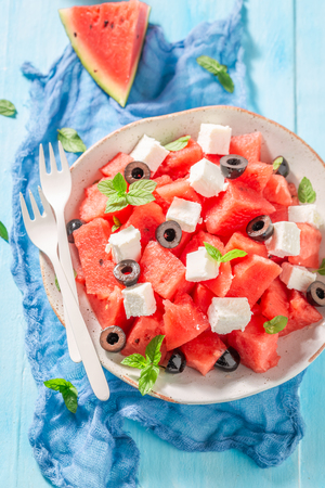 Tasty watermelon salad with feta, olives and mint leaves Stok Fotoğraf