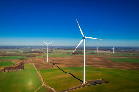 Aerial view of white wind turbines as pure energy