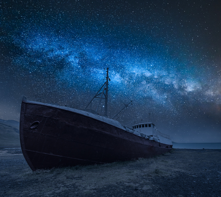 Shipwreck on the shore and milky way in Iceland