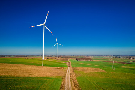 Flying above ecological wind turbines as alternative energy Banco de Imagens