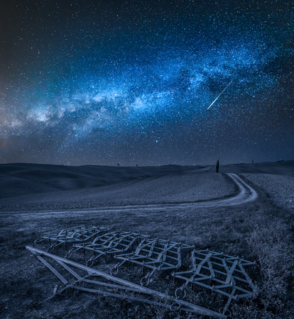 Milky way over Harrows on a brown field in Tuscany Stock fotó