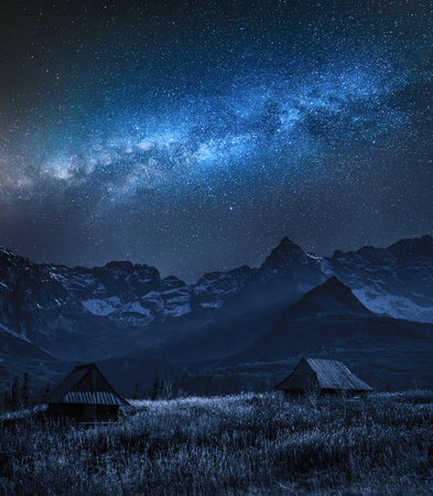 Milky way over Tatra mountain and small cottages, Poland