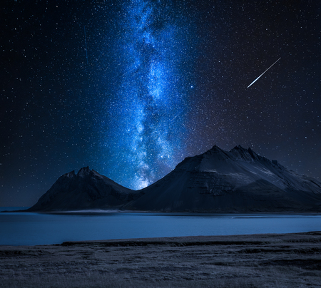 Milky way over the mountains by the sea, Iceland