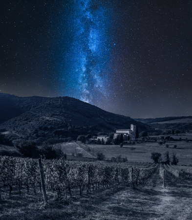 Vineyards and the monastery in Tuscany and milky way Фото со стока - 120540934