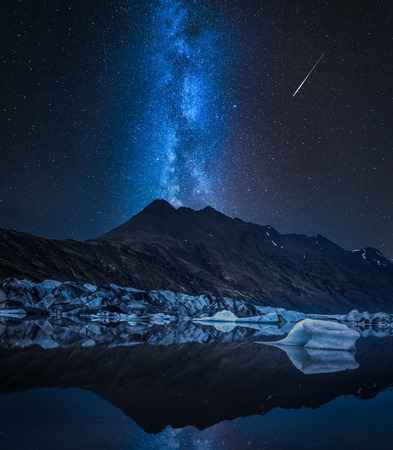 Milky way, huge glacier and cold lake at night, Iceland Фото со стока