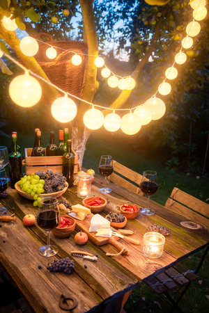 Preparation for supper with wine and fruits in the evening Stok Fotoğraf