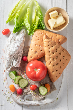 Delicious ingredients for sandwich with cheese, tomato and radish Stockfoto