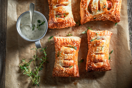 Crispy sausage in puff pastry as a snack for breakfast