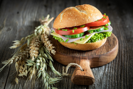 Delicious sandwich with lettuce, tomato and ham Banco de Imagens