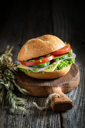 Homemade sandwich with lettuce, tomato and ham