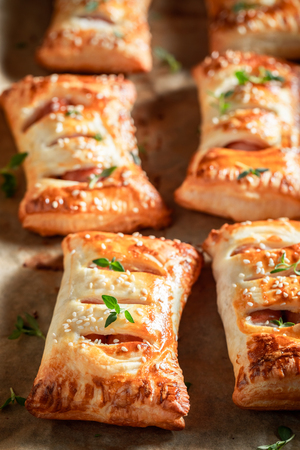 Hot sausage roll with thyme and sesame seeds