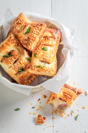 Fresh sausage in puff pastry as a snack for breakfast