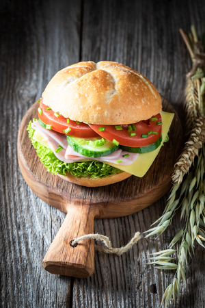 Tasty sandwich with lettuce, tomato and ham