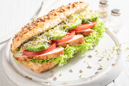 Homemade sandwich with grilled chicken, tomato and cucumber