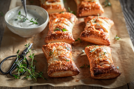 Hot sausage in puff pastry as a snack for breakfast Stock Photo